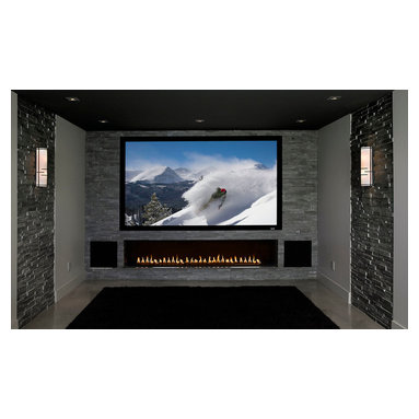 Home Entertainment Center with Custom Fireplace - One prevalent design trend is the placement of an entertainment screen over a fire feature or fireplaces. This may  seem like a visual contradiction with flames below distracting from what is happening on the screen yet,  if designed properly can make for a stunning residential or commerical entertainment setting.