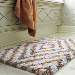"Frontgate - Grayton Ikat Bath Rug - 1-1/4"" thick mat. Made of 100% cotton yarns. Distinctive design offers a fresh look in bath rugs. Preshrunk with special softener for superior hand feel. Cotton bath rugs acquire a more lush texture with every wash. With our Greyton Ikat Bath Rug, soothing your soles in super-soft cotton yarns woven to 2,200 gsm is an experience you'll treasure each morning. This exclusive pattern, acquired through ikat dyeing, adds dynamic design to an extra-absorbent nonskid rug.. . . . . Offered in numerous colors to match your bathroom decor. Latex-treated back provides secure footing. Machine washable. Imported."