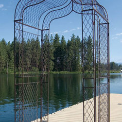 Garden Arbor - This arbors simplicity makes it a stately piece in any garden or backyard. The graceful curves of this garden arbor will delight the eye as it enhances the landscape. A wonderful transition piece from one point in your garden to the next, the Stanton Arbor can be enhanced with climbing vines or shrubs. Constructed of durable wrought iron, this piece is built to last.