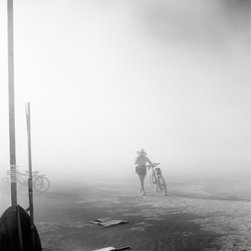 Art Artwork - a 20x24 inch Black & White photograph of lone bicycle rider walking into the dust with large letters spelling ART in the foreground.