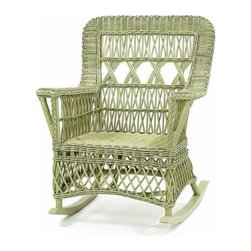 Loggia Wicker Rocker - This gorgeous wicker chair is pure Cape Cod or Hamptons style, that is to say, old school style, before all the teardowns happened. Capture a bit of nostalgia for a simpler, more charming time with this rocker.