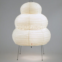 Noguchi Akari Table Lamp Model 24N - I do this weird thing where I look at an Akari lamp and imagine some adorable cartoon character. This one is a friendly version of the Stay Puft Marshmallow Man. Oh, it's also an iconic modern lamp designed by Isamu Noguchi.