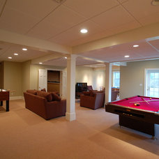 Contemporary Basement by Signature Construction and Design