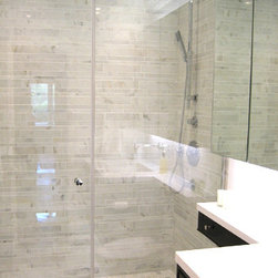 Sino Carrara - Sino Carrara Staggered Rectangles are used to create a contemporary shower.  Staggered Rectangles are available in other stones as well.