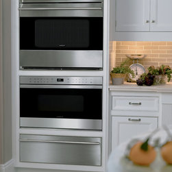 """Wolf 24"""" Traditional Microwave Drawer, Stainless Steel   MD24TES - Drawer microwaves can be installed undercounter, in a corner or in a wall of cabinetry which provides easy access to food from any angle. They are designed to match the trim style of Wolf E series ovens and can be installed in a standard or flush inset application."""