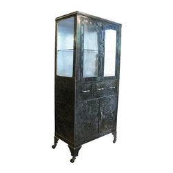 """Used Amazing 30s Double Door Medical Cabinet on Wheels - A well designed and functional 1930s stripped steel medical cabinet on wheels.    Two doors swing out to a 26""""  tall interior vitrine. The doors swing smoothly, the lock is present but the key is missing. One glass shelf comes with this cabinet and there is room inside for a few more. Three 5"""" tall full depth sliding drawers are in the middle of the cabinet and a 26""""  by 18.5""""  full depth storage space with two hinged doors is on the bottom.    The cabinet has been stripped to the bare metal on all exterior surfaces and sealed against rust. The rich patina has  plenty of character and its wear is consistent with age and use, some fading to the finish. (See pictures.)"""