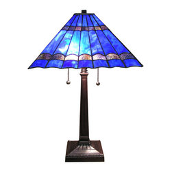 Warehouse of Tiffany - Tiffany-style Gothique Table Lamp - Bring a calming yet intricate touch to your bedroom or living room with this blue Tiffany-style table lamp that invites you to curl up next to it with a good book. It stands at 19 inches tall on a cast-metal base with an aged bronze finish.