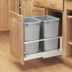 Rev-A-Shelf - Rev-A-Shelf Double Soft Close Pull Out 35 qt. Trash Can - 5349-18DM-2 - Shop for Organization and Storage from Hayneedle.com! The Rev-A-Shelf Double Soft Close Pull-Out 35-Quart Trash Can provides twice as much space to discreetly dispose of waste. The waste container set features heavy-duty brushed aluminum soft-closing slides that offer the support and stability needed to eliminate side-to-side movement. The durable plastic units are available in a white or metallic silver polymer finish. A fully adjustable door-mount frame has a built-in storage area for bags. Dimensions: 21.875L x 14.8125W x 19.25H inches. Minimum cabinet opening Width: 15 inches Depth: 22.125 inches Height: 19.625 inches About Rev-A-ShelfOriginally a division of Ajax Hardware Rev-A-Shelf was established in 1978 as a family-owned manufacturer of a variety of helpful home products. Rev-A-Shelf offers Lazy Susans kitchen drawer organizers cabinet and pantry pull-outs and functional waste containers. All products consist of polymer wire wood and stainless steel components which will seamlessly complement kitchen appliances and accessories. Rev-A-Shelf aims to revolutionize the way kitchens are organized across the country.