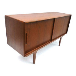 Timeless Simplicity Console - Handmade and environmentally-friendly, the Timeless Simplicity Console is made from reclaimed teak wood and since all wood is individual to itself, no two consoles are alike. Having two equally-sized compartments with adjustable shelving, this console can be used for just about anything. TV and movie collections, extra storage, record player and vinyl console�ۡ����you name it. Its high-quality craftsmanship means this console will far outlast its competition, while its architecturally-smooth lines make this a timeless piece you actually want to keep around.