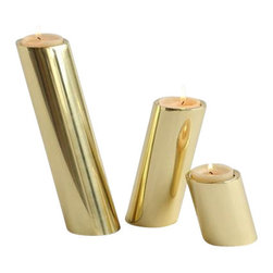 Brass Slanted Candle  Holders Set of 3 - These slanted candle holders are simple and stunning. Set of 3 can be arranged in a way that has unexpected movement. Holds standard tea light. Available in a shiny brass finish.