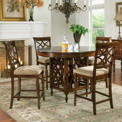 Standard Furniture Woodmont 5 Piece Counter Height Dining Table Set - 18th century-inspired open fretwork is fashion-forward and sure to add flair to your dining space - thank you Woodmont 5 Piece Counter Height Dining Table Set. In addition to the light airy fretwork on the chair backs and table base this dining set also dazzles with its vase-shaped turned legs cushioned slip seat upholstery and rollback chair tops. And don't forget the rich brown cherry stain - you'll love its dark edge shading. You can also add the optional server to your order. Fretwork adorns the two cupboard doors while the two drawers have a checkerboard inlay border. Vase-shaped turned legs and antique nickel-finished hardware complete this classic design. Dimensions: Table: 48L x 48W diameter x 36H inches Chair: 24W x 18D x 43H inches; seat height: 24 inches Server: 52W x 18D x 38H inches About Standard FurnitureFounded in 1946 as a family owned American-based company Standard Furniture operates their own manufacturing and distribution facilities in Bay Minette and Frisco City Alabama with more than 80% of their entire workforce based out of the United States. Their 1.4 million square feet of manufacturing space 1.5 million square feet of warehouse space and more than 40 trucks enable them to keep up with customer demand. Their main focus is to assist their customers in growing their retail businesses by supplying products that will sell due to quality design and value. As one of the leading case goods manufacturers in the market Standard Furniture's continual growth and presence in the market place has remained steady over the last 60 years.