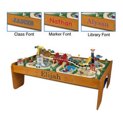 KidKraft - Personalized Ride Around Town Train Set with Table - With the exciting Ride Around Town Train Set with Table, the young conductors in your life have an entire busy community at their fingertips! The train set will provide kids with hours of imaginative play while the table helps keep playtime off the floor and closer to eye level. Features: -Includes one hundred colorful train pieces, buildings and accessories, moveable crane, airport with runway and helipad and hospital with ambulance -Two bins for convenient storage -Large enough to accommodate multiple playing children -Made of wood -compatible with Thomas and Friends wooden train sets and Brio wooden train sets -Other Imagination Express toys from KidKraft available separately -Limit 10 characters- letters A-Z only.