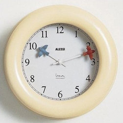 """Alessi - Michael Graves Kitchen Wall Clock - Add a unique touch to your kitchen walls with this Kitchen Wall Clock! Keep an eye on your food with this clock with unique hands! Features: -Wall clock.-Quartz movement.Specifications: -Dimensions: 3.6"""" H x 10"""" W.-Handwash recommended."""