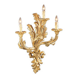 "Inviting Home - Louis XV Sconce - Louis XV style three-lights wall sconce in antiqued gold leaf; 15-1/2"" x 21-1/4""H; hand-crafted in Italy; Sculpted in foliate design this carved wood wall sconce retains the overall Louis XV style configuration. The curvaceous shapes of the sconce would retain a familiarity for those holding on to tradition. The distinct sculptural qualities and deep relief surface ornamentation reinforced by three freely curved arms of the sconce with leaf motif recall characteristics more commonly associated with the Louis XV style. The graceful design of the sconce is accentuated by an antiqued gold leaf finish the sophisticated combination of these two creatively are married into a timeless statement of beauty. UL approved - dry location; hardwire; 3x 60W max. candelabra bulds; bulbs not included. Handcrafted in Italy."