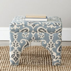 Safavieh Grant Ottoman - Blue - Try our Safavieh Grant Ottoman - Blue for a thousand and one nights and see how comfortable and luxurious this ottoman is. This rich blue ottoman has an exotic Ikat design made with a luxurious cotton and linen blend. The Moorish arches are lined in a stunning silver nailhead trim. And its plush foot cushion provides comfort for a thousand more nights to come.About SafaviehConsidered the authority on fine quality, craftsmanship, and style since their inception in 1914, Safavieh is most successful in the home furnishings industry thanks to their talent for combining high tech with high touch. For four generations, the family behind the Safavieh brand has dedicated its talents and resources to providing uncompromising quality. They hold the durability, beauty, and artistry of their handmade rugs, well-crafted furniture, and decorative accents in the highest regard. That's why they focus their efforts on developing the highest quality products to suit the broadest range of budgets. Their mission is perpetuate the interior furnishings craft and lead with innovation while preserving centuries-old traditions in categories from antique reproductions to fashion-forward contemporary trends.