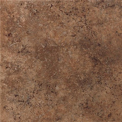 Vallano in Dark Chocolate - Vallano is a rustic tile with a surface visual of lightly weathered stone. It features a complex color palette of rich browns and golds that lend a touch of elegance to both contemporary and traditional settings. A variety of glazes are employed to subtly vary the shading of each tile and add even more visual depth. With its many modular sizes, Vallano makes creating patterns on floors, walls, countertops and backsplashes a simple task. A diverse selection of wall and countertop trim shapes, natural stone borders and carved leaf wall accents add to its versatility.