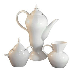 Used Lindt-Stymeist Whiteways Coffee Set - A stunning Lindt-Stymeist Whiteways coffee service set. It includes a textured white porcelain coffee pot, creamer and sugar bowl with wave patterns, designed by John Stymeist in the early 1990s and made in Japan. Whiteways' whimsical pattern (the sugar bowl's handles are asymmetrical because the small loop was for a small porcelain spoon, which is missing) was not a commercial success like Colorways, so this set is extremely rare, and in perfect condition.