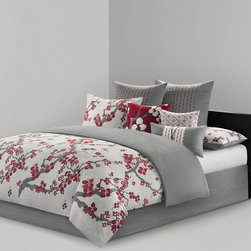 N Natori - N Natori Cherry Blossom Comforter Set - Create an oasis out of your space with the Natori Cherry Blossom Bedding Collection. This elegant comforter set features a 300 thread count cotton sateen face with light grey ground and cherry blossom branches inching up to the top. The heather grey reverse has a 200 thread count cotton sateen dark for a dramatic feel. The heather grey continues onto the solid bedskirt for a beautiful color scheme that is easy to place in any room. Face: 300TC 100% cotton sateen with pirnt; Back: T200 100% cotton sateen print; filling: 100% polyester