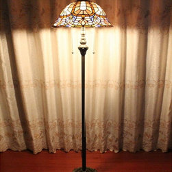 Petaled Victorian Tiffany Floor Lamp - Beautiful colors of blue and violet abound in this Petaled Victorian Tiffany Floor Lamp. The decorative resin base is topped with a softly scalloped shade using art glass in a copperfoil technique. Two balls with pull chain handles allow for a little or a lot of light in your room. The top metal filigree adds a bit of softness to the lamp. The lamp includes delicate blue flowers and an almost shell look.