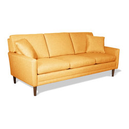 "True Modern - Circa Standard Sofa, Wheat - Channel that ""Mad Men"" feeling into your favorite setting. This streamlined sofa, designed by Edgar Blazona, perfectly captures that mid-century modern vibe with the sleek, classic lines you love - wraparound sides, just-plush-enough cushions and sturdy, solid walnut legs."