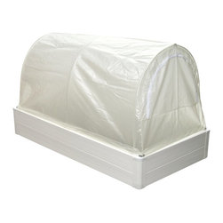 Guarden - Guarden GK Series Deep 3 x 6-Foot Mini Greenhouse - GK3672D - Shop for Greenhouses from Hayneedle.com! Additional FeaturesChange covers dependent on the seasonsCover doubles as a season extenderCover features a dual-purpose hinge/latchCover can be opened from either sideHas the features of a raised-bed greenhouseUnlimited root depth compactness and drainageLift out hoops convert the greenhouse to a raised bedConversion doesn't require toolsHeavy duty plastic frameFrame has 3 internal insulating air cellsAir cells keep the soil's heat from escapingFrame will not fade crack rot or splitBeautiful rounded cornersPre-drilled holes and push-in fasteners make assembly easyTitanium Dioxide protects against UV raysLightweight and solidly constructedYou can add heating irrigation or other accessoriesCan be used in your yard patio deck or platformEnjoy having greenery throughout the year with the Guarden GK Series Deep 3 x 6-foot Mini Greenhouse. Whether you're a novice gardener or living in a place with very little room for a greenhouse or traditional garden the mini greenhouse is a great place to start. Measuring only 36W x 72L x 40.5 inches this mini greenhouse will fit into the smallest of places. Just add a liner and it can even be placed on a porch platform or deck.Combining the benefits of a traditional greenhouse with plenty of plant headroom with the solar heat of a cold frame and the unlimited soil depth compactness manageability and convenience of a raised bed the mini greenhouse has all the features you need without the size. The frame is constructed from durable plastic and will not rot fade crack or split. The Titanium Dioxide protects your plants from UV rays while three internal insulating cells keep your soil warm. It's easy to convert your mini greenhouse to a raised bed with the lift out hoops that don't require tools. The cover doubles as a season extender and features a dual hinge/latch that allows you to open it from either side. The rounded corners of the frame add a beautiful touch and the Deep Mini Greenhouse adds an extra five inches to help showcase your plants.
