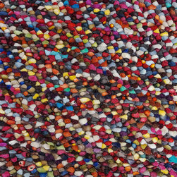 House Party Rug - There's more to you than meets the eye. You're fun-loving enough to own this vibrant rug woven of felted yarn tubes, but serious enough to insist on 100-percent wool. The best part: This rug is dust-, heat- and moisture-resistant.