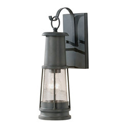 Feiss - Chelsea Harbor Outdoor Wall Sconce Lantern - Chelsea Harbor Outdoor Wall Sconce Lantern is available in a Storm Cloud finish with Clear Seeded glass.  Available in small, medium or large.  Available with incandescent or LED lamping.  Small: Incandescent: One 60 watt, 120 volt A19/Medium base Incandescent lamp is required but not included. LED: Includes one 6 watt, 120 volt LED.  4.75 inch width x 16.1875 inch height x 7.0625 inch depth.  Medium: Incandescent: One 100 watt, 120 volt  A21/Medium base Incandescent lamp is required but not included.  LED: Includes one 6 watt, 120 volt LED.  5.75 inch width x 20.125 inch height x 7.875 inch depth.  Large: Incandescent: One 100 watt, 120 volt  A21/Medium base Incandescent lamp is required but not included.  LED: Includes one 6 watt, 120 volt LED.  7 inch width x 24 inch height x 9.0625 inch depth.  UL Listed for Wet Locations.