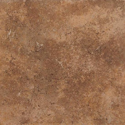 Vallano in Caramel - Vallano is a rustic tile with a surface visual of lightly weathered stone. It features a complex color palette of rich browns and golds that lend a touch of elegance to both contemporary and traditional settings. A variety of glazes are employed to subtly vary the shading of each tile and add even more visual depth. With its many modular sizes, Vallano makes creating patterns on floors, walls, countertops and backsplashes a simple task. A diverse selection of wall and countertop trim shapes, natural stone borders and carved leaf wall accents add to its versatility.