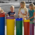 Tuned Drums - These Five tuned hand drums are made with replaceable plastic heads ranging from seven inches to fifteen inches in diameter. The drums can be ordered in standard or preschool heights to suit your needs. The bases of the drums can be permanently installed directly into the ground in your choice of arrangement. The drums can be painted in any combination of colors. They make ideal playground equipment.Two stock color choices are: Primary Rainbow – or – all green drum bodies, with molded caps in; Yellow, Blue, Moss, or Taupe.
