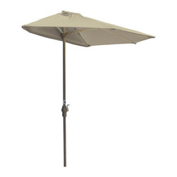 """Blue Star Group - OFF-THE-WALL BRELLA 9 Ft. Half Umbrella - Antique Beige - Sunbrella Fabric - What a great new idea!  OFF-THE-WALL BRELLA is a half-canopy patio umbrella that stands, without attachment, flush against a wall, window, sliding glass door or any vertical surface.  This decorative and portable faux-awning provides cooling shade and welcomed protection from the elements.  Now, homeowner's and condominium dwellers alike can open their drapes to enjoy the view and be sheltered from the hot sun or rain.  The Antique Beige canopy is made of Sunbrella Fabric fabric for long lasting durability and color.  The sturdy frame has a tough, powder coat, Champagne color finish and a hand crank for easy raising and lowering of the canopy.  Fully opened, the umbrella stands 99"""" H x 106"""" W x 54"""" D.  When closed, the upper pole and canopy can be separated from the lower pole for compact storage."""