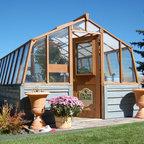 Tropic style greenhouse kits - 10x14 Greenhouse, redwood frame, on customer built wood base.