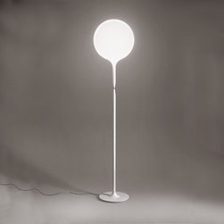 Artemide - Artemide | Castore Floor Lamp - Designed by Michele De Lucchi in 2003.The Castore, is a floor lamp that provides diffused incandescent or halogen lighting. If features a diffuser in white hand-blown glass, with external etched finish. Available in two sizes. Stem crafted of steel tubing, with the upper covered by a tapered sleeve in white translucent molded polycarbonate, allowing for partial soft diffusion of light from diffuser, and the lower part in a white epoxy finish. Base in die-cast metal alloy with matte white epoxy powder finish. Includes dimmer activated by chrome steel ring positioned between upper and lower stem sections.