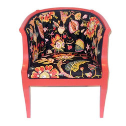 Pre-owned Poppy Club Chair with Floral Print - This Mid-Century Modern club chair was screaming to be rescued, and it's been totally transformed. The wood frame, featuring cute curved lines, was painted a pretty poppy color and the seat and back were reupholstered in a black floral fabric with pops of color.
