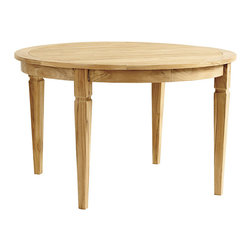 Ballard Designs - Classic Teak Round Dining Table - Pair with our Madison Collection, Laurel Collection and West Hampton Collection. Center hole with teak plug for standard umbrella. Slats allow water to drain through. Made of FSC certified teak. Assembly required. With its airy slatted top and crisply tapered legs, our Classic Teak Round Dining Table has a timeless look designed to last. It's hand crafted of solid FSC-certified teak, making it naturally resistant to harsh weather and damaging insects. If left untreated, teak finish will mellow to a warm silvery gray over time. Classic Teak Round Dining Table features:. . . . .