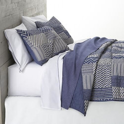 Aman King Quilt - Ethnic-inspired patches of blue-and-white chevrons, herringbones, and casual stripes print on soft 100% cotton with the heirloom look of patchwork. Filled with warming fill, cotton shell is quilted for a lightweight, insulating layer that works great on its own in warmer months. All linens reverse to solid blue. Sham has generous overlapping back closure. Bed pillows also available.