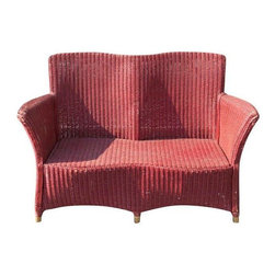 "Janus et Cie Child's Red Wicker Sofa - A Kid's Delight!  Add this red wicker sofa to your children's room for a comfy spot to read, complete homework, or hang with friends. A purchase like this will get you extra parent points to use against that pesky chore chart. Seat measures 10"" high."