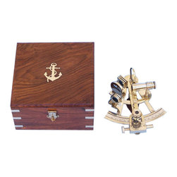 """Handcrafted Model Ships - Captain's Brass Sextant 6"""" Beach Home Decorating Antique Sextant Decor Nautical - This Hampton Nautical premium quality Captain's Sextant is a beautiful full-scale reproduction of the British Captain's 6-inch radius vernier readout brass nautical sextant. Each sextant is expertly crafted from solid brass and marked with a unique serial number. The sextant has an accurately divided German Silver scale, and a gear driven slow motion control for making small adjustments to the index arm. A powerful magnifier can be swung into position to assist in reading the vernier scale. The sextant's telescope has polished glass lenses and produces a sharp magnified image. The index mirror has three recessed adjustments. There are six tinted swing-arm filters with heavy brass filter mounts. On the back of the sextant is a hardwood handle with a thick brass plaque engraved """"Hampton Nautical"""" and the unique serial number. The sextant comes with a beautiful felt-lined hardwood case with an inlaid brass and the Hampton Nautical anchor with rope logo embedded into the top of this smooth and polished hardwood box. The dimensions listed are the dimensions including the box."""