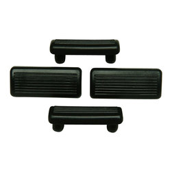 Marcel Breuer - Breuer chair Double Prong Glides - Replacement Flat Plastic Caps (Set of 4) - Breuer chair Double Prong Glides - Replacement Flat Plastic Caps in Black. The Breuer chair Glides will protect your wood, laminate, tile or stone floors by virtually eliminating scratching.  These are made of heavy rubber and are designed for Breuer style chairs.   These caps will fit into the holes of any tubular frame metal chair.  Frame must have two holes on bottom for glide to fit properly.  Simply remove existing clips and tap into holes.  This quality plastic caps is Made in Italy. Caps are sold in sets of four.