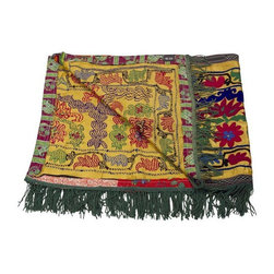 Pre-owned Vintage Satin Suzani Runner - This captivating vintage Suzani runner features traditional embroidery across the yellowish-gold silk background, creating a multitude of floral carnations and textures. The exquisite hand embroidery and tassels are in rich color tones. The distinctive designs and slight irregularities give this piece a unique level of character and versatility.