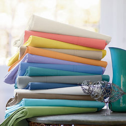 Company Cotton Solid Sheets - Give your bed a summer boost with brightly colored sheets.