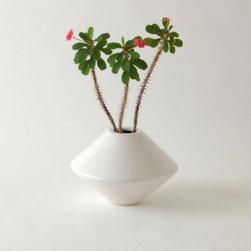 Vessel in1 ceramic planter - This series of planters are striking alone or in a group. Order them in multiple colors for a striking focal point or plant one to use as a centerpiece. This mid century modern planter would look great on the ground, on a table or in a stand.