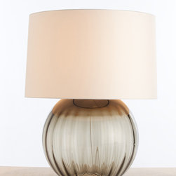 Orville Smoke Gray Optic Glass Lamp - Design sophistication soars with this ample globe of optic glass crowned with a low-set fabric drum shade of contemporary scale. Enhancing the modernity, light reflects along its subtly contoured surface, gracing the ribs of glass with illumination and creating dark shadow accents.