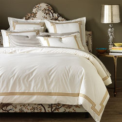 DwellStudio - Regent Duvet Cover by DwellStudio - A royally refreshing take on embroidery. The DwellStudio Regent Duvet Cover is mostly white with a sharp contrasting frame embroidered by machine around the entire border. The effect is at once fresh and timeless. This cover is made out of machine washable cotton percale. Shams sold separately. DwellStudio, founded in 1999 by Christiane Lemieux, specializes in home furnishings steeped in modern design. With a unique sense of color and a strong commitment to quality and innovation, DwellStudio continues to create its own distinctive interpretation of modern home furnishings. In the same creative spirit, the company encourages their customers to experiment with mixing various DwellStudio textile lines together.