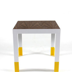 Dip Side Table - Each table is built to order in our shop. The steel structure is constructed with 2x2x1/8� steel angles. The structure is then painted with a satin white. The top is made with hardwood veneer plywood; walnut, finished with tung oil. The legs are finished with rubber tips to give the desk a no slip grip on the floor.