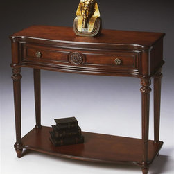 Butler - Antique Console Table in Plantation Cherry Fi - Plantation Cherry finish. Selected solid woods, wood products and choice veneers. Cherry veneer top, sides, drawer front and lower display shelf. Drawer with resin appliqu��� and antique brass finished hardware. 37 in. W x 15.75 in. D x 34 in. H