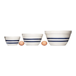 Hand-Finished Stoneware Mixing Bowls - During the holiday season, there always seem to be about a million reasons to bake. I like this set of mixing bowls for their heft and simple design. I wouldn't mind using them to serve a big bowl of mashed potatoes either.