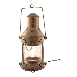 """Handcrafted Model Ships - Antique Brass Ship Anchor Electric Lantern 20"""" - Brass Nautical Lamp - This antique brass ship anchor electric lantern 20"""" is a beautiful handcrafted production of heavy brass cast hardware. This lanterns provides fantastic emergency lighting or like their oil wick counterparts, these electric lanterns can provide historic and authentic nautical decor. There is a thick clear glass lens which shows an illuminated arc of 225 degrees. Each contains an interior corrugated silvered brass reflector. The oil burning pot and wick unit that was serviced from the bottom of the lanterns has now been converted into an electric fixture. There is room inside for a full size 40w light bulb. Some the applications that our electric lanterns have been used for include, wall lanterns, outdoor lanterns, ships wheel chandeliers, exterior lighting, ceiling fixtures and end table lamps. They also make perfect patio/deck electric lamps. You can also choose to mount them on your wall or post. The back is fitted with one thick cast brass mounting bracket which is riveted to the body of the lamp for extra support. All hardware is included. They are of -Solid brass construction, not to be confused with the cheaper painted or plated varieties. Ideal gifts for people who love nautical lamp memorabilia."""