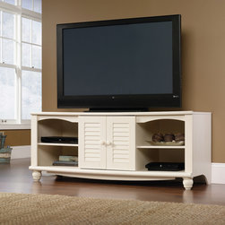 Harbor View Entertainment Credenza - Two adjustable shelves hold audio/video equipment. Storage area behind louver detailed doors has an adjustable shelf and holds VHS tapes, DVDs, and CDs. Detailing includes solid wood knobs and turned feet. Antiqued White finish.