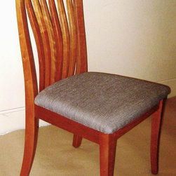 THIN CREST SIDE CHAIR - Our dining chairs come in a variety of styles and woods. We have a selection of arm styles to chose from, as well. Many of our chairs come with a carved wood seat option, graded upholstery options, or C.O.M. or C.O.L options as well. Since we build to order, we can adjust the seat height, arm style and length, and seat cushioning to meet your individual needs.