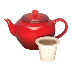 Le Creuset - Le Creuset Stoneware 22-Ounce Teapot with Infuser - For a truly memorable cup of tea, whole-leaf loose varieties offer a full spectrum of flavors and infusions. The graceful, classic styling of this small teapot fits into any kitchen, while its specially designed infuser insert makes it easy to add loose leaves to hot water for steeping and pouring the perfect cup. Its the perfect size for tea for two.